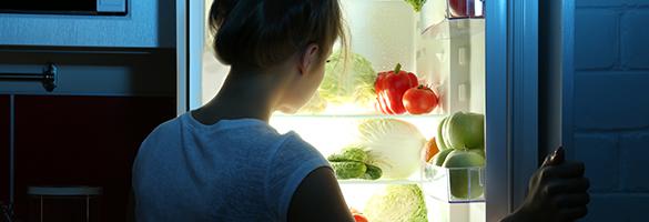woman-infront-of-open-fridge